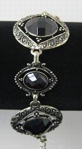 Armband antiek goud met zwart glas  per stuk