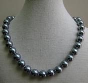 Parelketting 12mm grijs/blauw schelp parelmoer per stuk